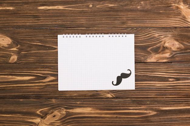 Notebook and ornamental mustache