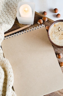 Notebook paper, plaid, candle and coffee cup
