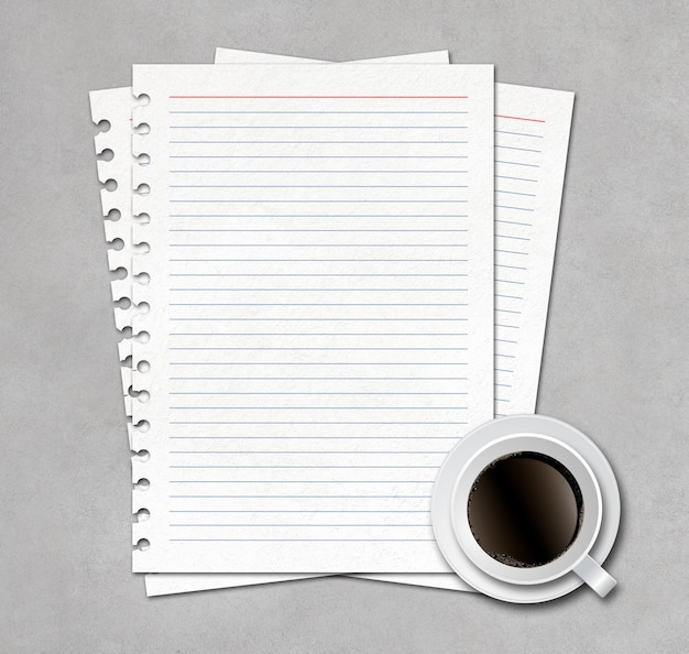 Notebook paper with cup of coffee on concrete background
