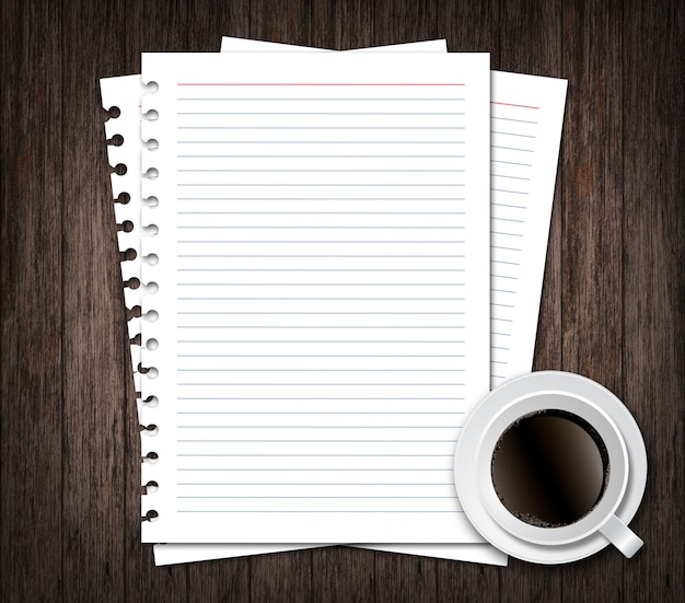Notebook paper with cup of coffee on wood background