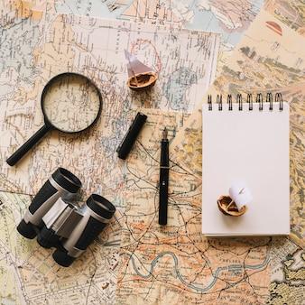 Notebook and pen near travel stuff