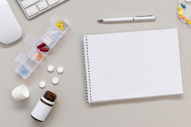 Notebook and pills on table