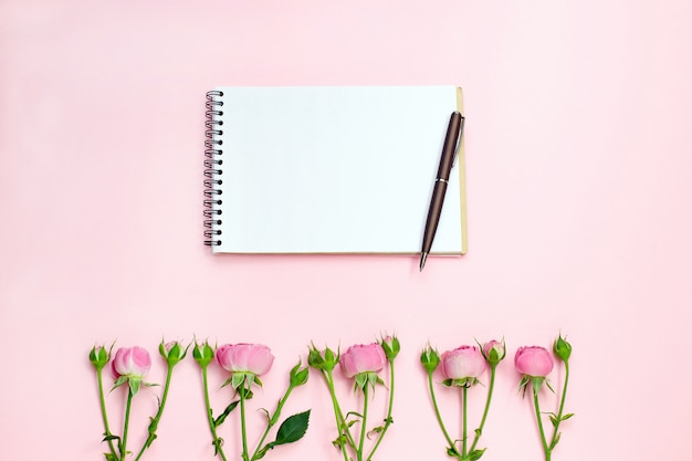 Notebook and pink flowers