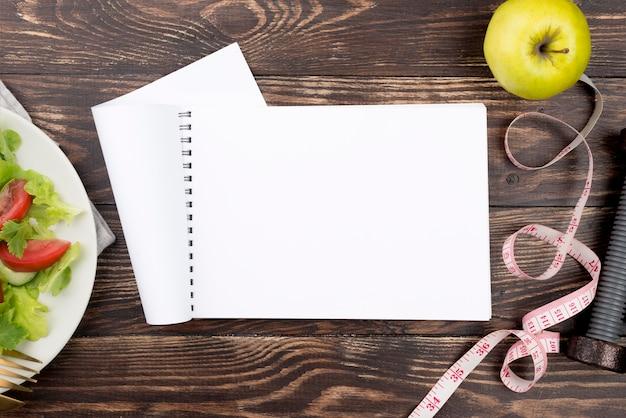Notebook and salad arrangement