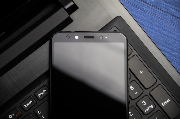 Notebook and smartphone copy space. modern mobile with camera. top view.
