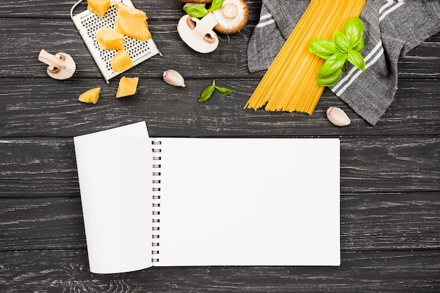 Notebook and spaghetti with mushrooms