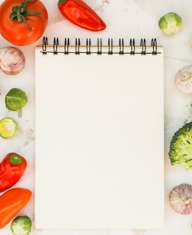 Notebook and vegetables