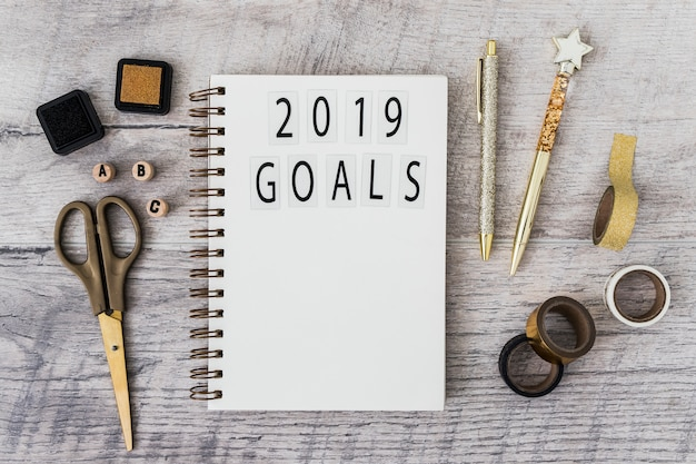 Notebook with 2019 goals inscription near set of stationery