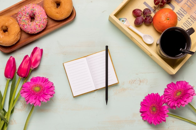 Notebook with arrangement of sweet breakfast