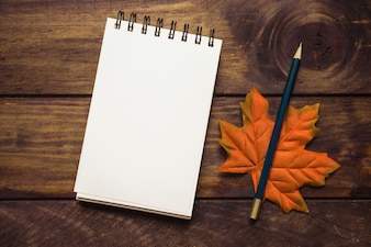 Notebook with autumn maple leaf composition