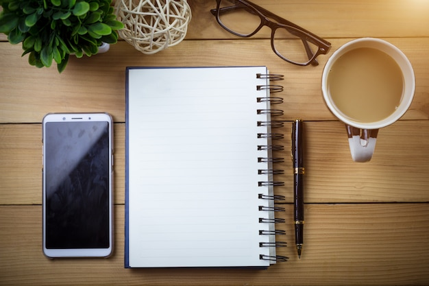 Notebook with blank pages on wooden table.