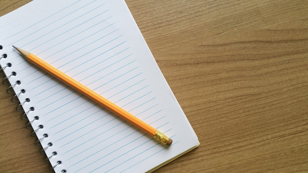 Notebook with blank sheets with pencil.