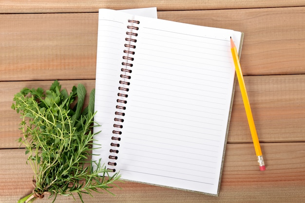 Notebook with a bunch of herbs