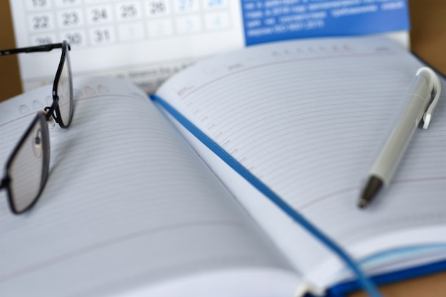 Notebook with a calendar for notes on the desktop