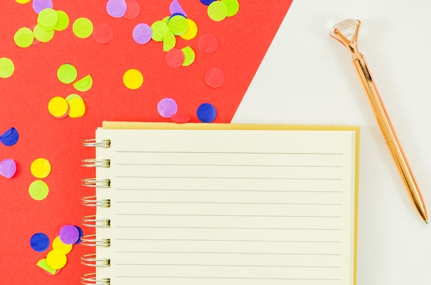 Notebook with colorful confetti