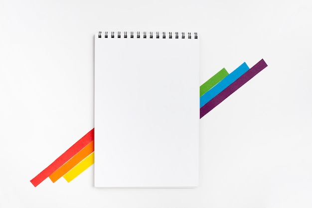Notebook with colorful paper pieces