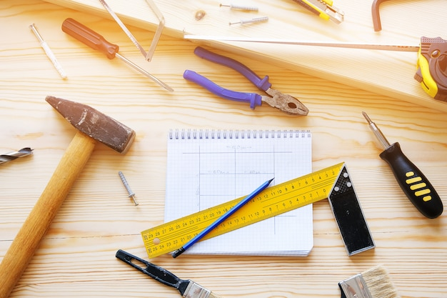 Notebook with drawings and construction tools for building a house or apartment repair.