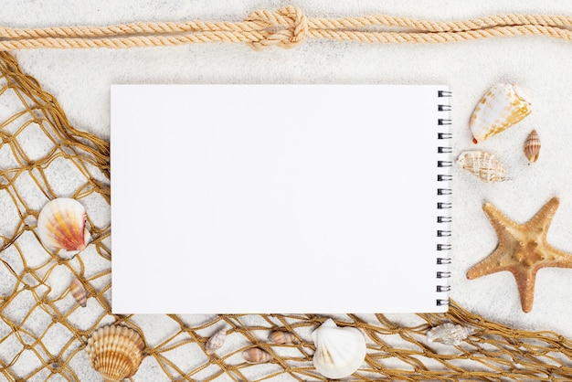 Notebook with fish net beside