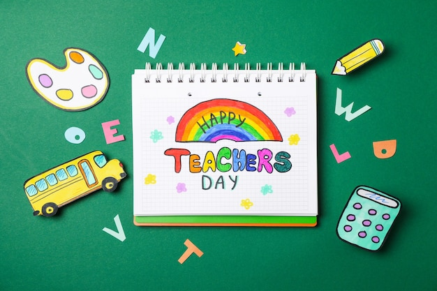 Notebook with happy teachers day and decorative school supplies