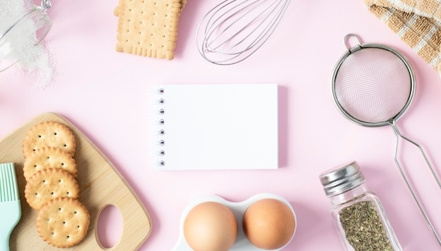 Notebook with ingredients and kitchen tools