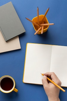 Notebook with to do list on desk with cup of coffee beside