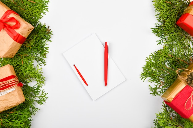 Notebook with pen on christmas space