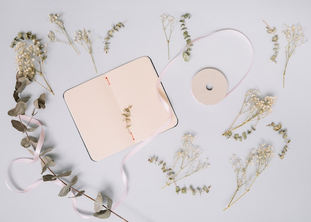 Notebook with small branches on table
