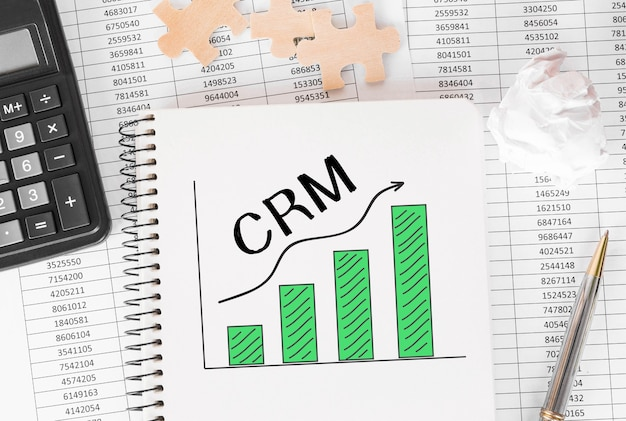 Notebook with toolls and notes about crm,concept.