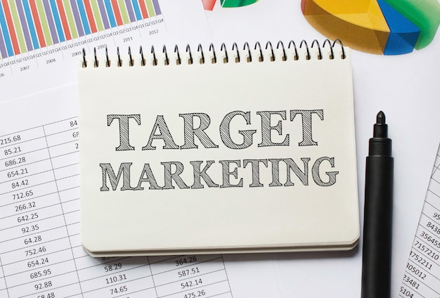 Notebook with toolls and notes about target marketing