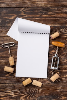 Notebook with wine stoppers and corkscrew