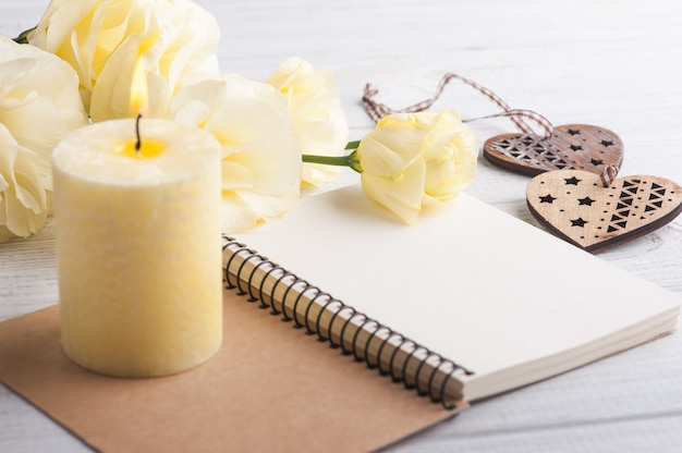 Notebook with yellow lisianthus flowers