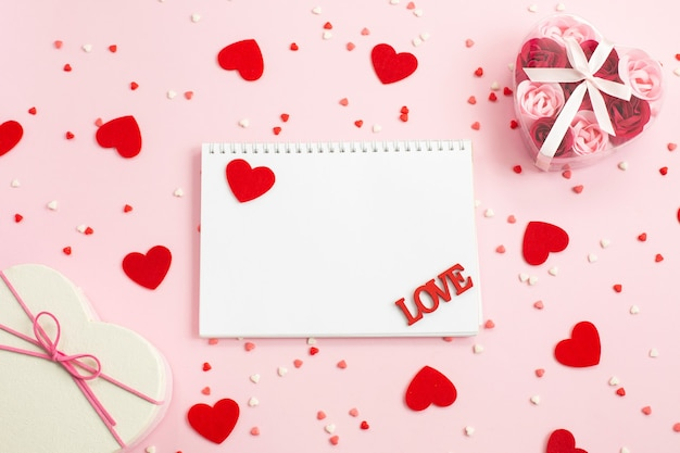 Notebook for writing with red hearts and gift boxes
