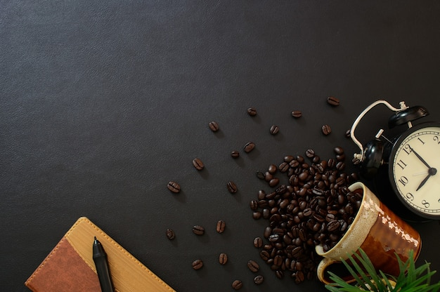 Notebooks and coffee beans on the desk top view