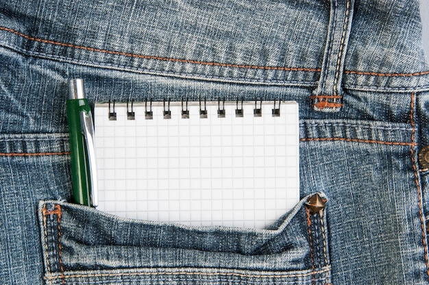 Notebooks and pen in pocket