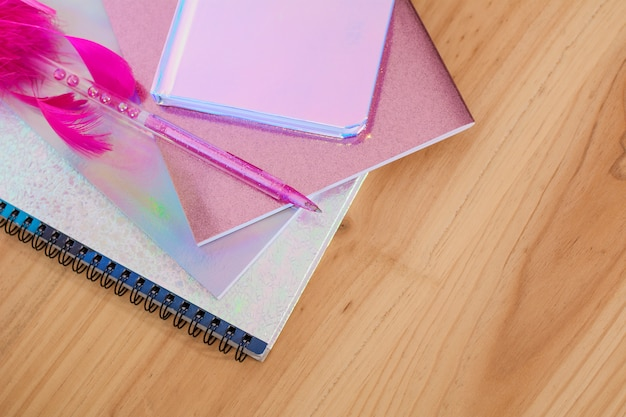 Notebooks and pens with glitter