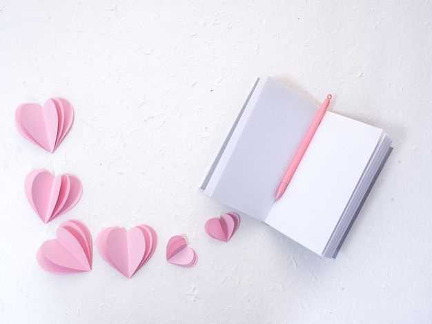Notebooks with pink paper hearts