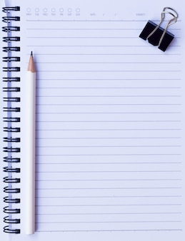 Notepad background with pencil