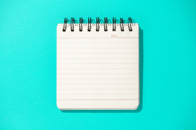 Notepad on blue surface