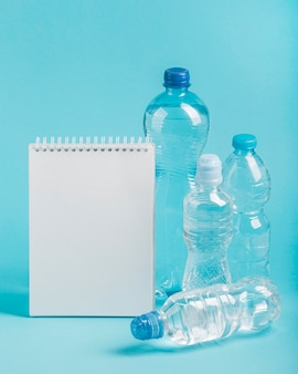 Notepad and bottles of sparkling water