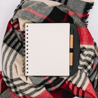Notepad on checkered scarf