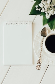 Notepad and coffee on a light background