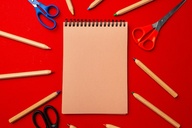 Notepad and color pencils, stationery on working space, top view, flat lay