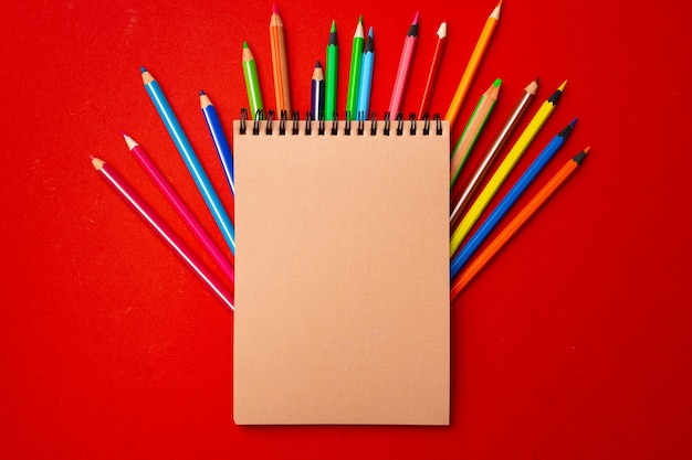 Notepad and color pencils, stationery on working space