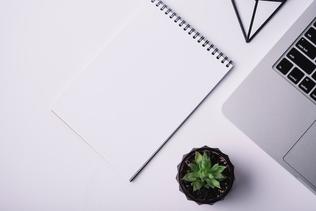Notepad cover template on desk with laptop