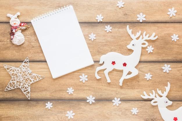 Notepad between decorative deer and star