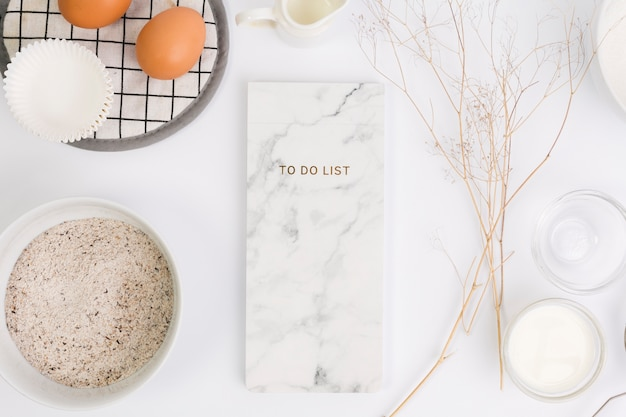 Notepad and healthy ingredient for cooking on white background