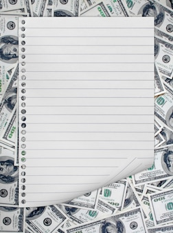 Notepad isolated on banknotes background