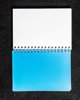 Notepad located on black background