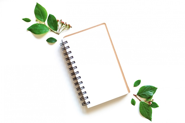 Notepad mockup leaves in paper art style on green