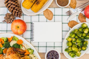 Notepad on festive table with food